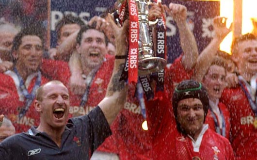 Gareth Thomas and Michael Owen as joint captains lift the RBS 6 Nations Trophy at the end of the 2005 Championship