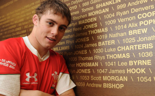 Leigh Halfpenny, prior to winning his first cap in 2008, stands beside the International Honours Board at the Millennium Stadium listing the name of every Wales international and their cap number
