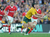 Australia fly half Berrick Barnes flings the ball out to his backs during his side's 20-19 victory.