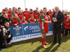 Bryncethin's captain Lloyd Jenkins receives the trophy from WRU Board Member Alan Jones.