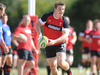 Jonathan Davies whips the ball out during training.