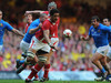 Toby Faletau skilfully offloads under duress against Italy.