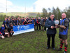 Glyncoch Captain Andrew Edwards is presented with the Division 6 Central trophy by WRU Board member Ray Wilton.