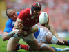 Leigh Halfpenny is denied a certain score with a brilliant tackle by Sergio Parisse.