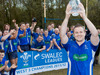 Haverfordwest skipper Dai Williams holds the SWALEC Division 3 West trophy aloft with his team mates behind.