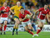 Wales replacement James Hooks dances his way through the Wallaby defence.