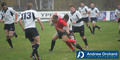 IRBU21 2005: Wales U21's Gerwyn Price defends the ball from Sean Tomes's tackle