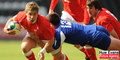 Wales scrum half Rhys Webb is tackled by French centre Henry Chavancy in the Pool D clash at the Liberty Stadium