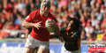 Wales U20 centre Jonathan Davies evades a tackle from South Africa's Cecil Afrika