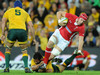 The Wallaby defence just manages to contain the charging Alun Wyn Jones.