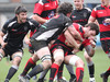 The Cross Keys defence struggles to contain Aberavon flanker Chris Davies at Pandy Park.