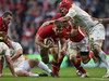 Wales flanker Dan Lydiate burrows his way through the England rearguard.