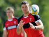Mike Phillips passes the ball during training in Brisbane.