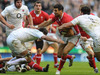 Mike Phillips is mobbed by the England defence at Twickenham.