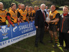 WRU Board member Aurwel Morgan presents the Division 6 West trophy to Pontrhydyfen skipper Andrew Price and coach Alan Flowers.