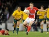 Wales fly half Rhys Priestland side steps the Wallaby defence as Mike Phillips looks on.