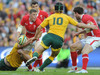 Rhys Priestland looks for support as the Wallaby defence closes him down.