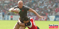 Gareth Thomas is tackled by Mike Pyke in Wales's opening Pool B clash of the 2007 Rugby World Cup