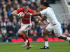 Manu Tuilagi grapples with his opposite number Jamie Roberts.