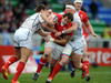 Wales captain Rhys Shellard sets the tone as he rampages into the Russian defence.