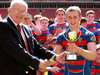 WRU's Aurwel Morgan presents Tondu Youth captain Lewis Jones with the trophy.
