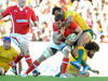 Kurtley Beale climbs all over Sam Warburton to prevent the Wales skipper from offloading the ball.