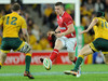 Scott Williams chips the ball in behind the Wallaby defence during his side's 27-19 defeat.