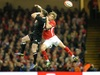 Liam Williams competes for a high ball with Cory Jane