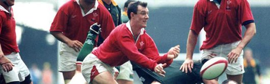Scrum half Rob Howley clears Welsh ball during the historic match