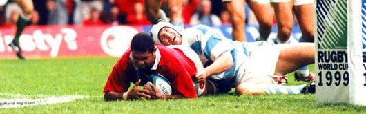 Colin Charvis grounds the opening try of the 1999 Rugby World Cup in front of an emotional capacity Home crowd