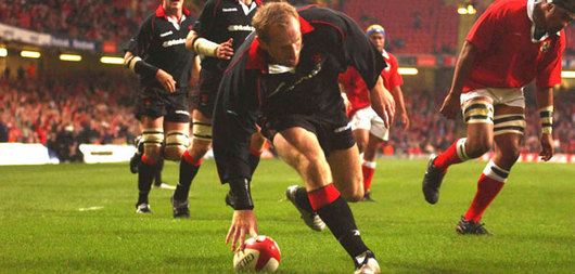 Gareth Thomas strolls over for Wales's first of six tries against Tonga