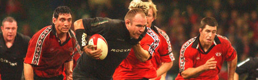 Scott Quinnell bowed out of international rugby with a final flourish in front of the home crowd