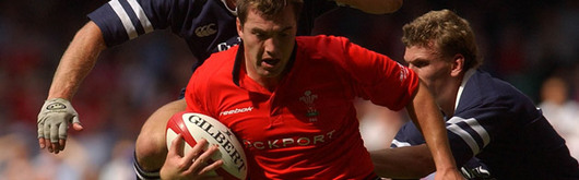 Iestyn Harris rides the challenge of Scotland during the 2003 WRU Summer Series