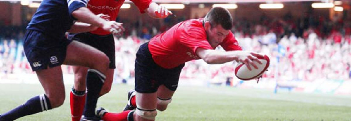 Michael Owen scores his first try during Wales's WRU Summer Series victory over Scotland