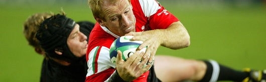 Ali Williams and Gareth Thomas tussle in what proved to be the match of the tournament during the Pool Stages