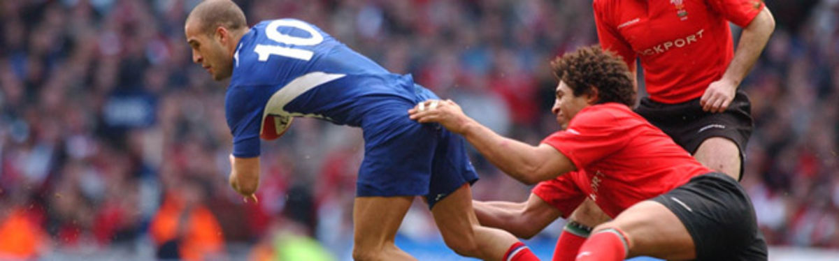 Colin Charvis grasps at Frederick Michelak during the recent Wales v France encounter