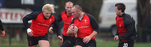 Robin McBryde takes on Duncan Jones, Gareth Thomas and Ceri Sweeney in training at London Welsh