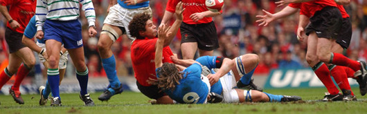 Colin Charvis offloads during Steve Hansen's farewell against Italy in the 2004 RBS Six Nations at the Millennium Stadium