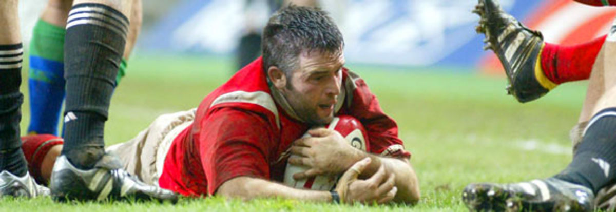 Mefin Davies scores against the All Blacks in November 2004
