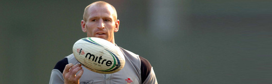 Gareth Thomas gets to grips with the Italian's match ball which caused the Irish concern on Sunday