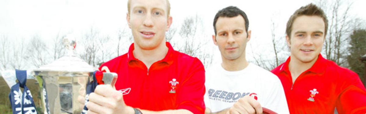 Two of Mike Ruddock's praised heroes, Tom Shanklin and Rhys Williams, flank proud Wales and Manchester United legend Ryan Giggs with the Six Nations trophy