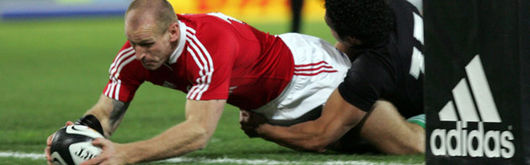 Gareth Thomas scores in the opening minutes to give the Lions the perfect start, but once New Zealand had dusted themselves down they returned to win the series