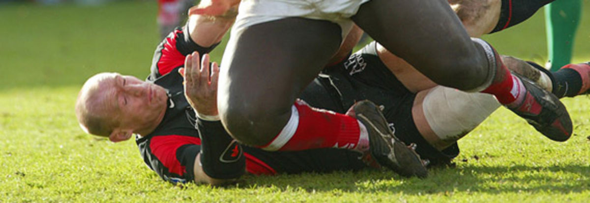 Gareth Thomas attempts a last ditch tackle on Martin Madden in the sixth round Heinken Cup clash between the Scarlets and Toulouse last weekend