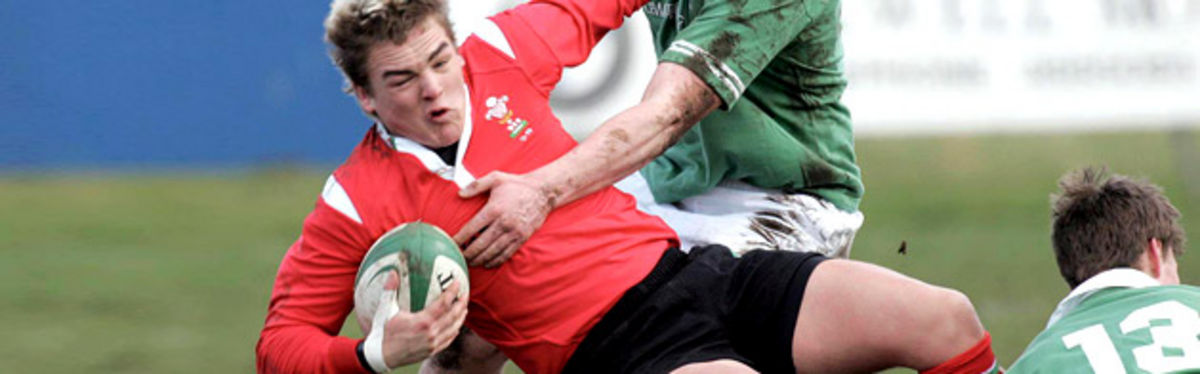 Gareth Maule is tackled by Ian Whitten and Kyle Tonnetti in last season's Ireland v Wales U19 clash