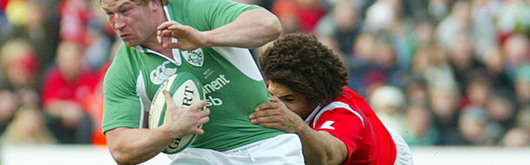 Charvis tackles Jerry Flannery at Lansdowne Road