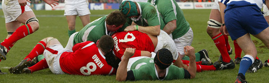 David Wallace crosses the Wales defensive line as Charvis and Owen attempt to keep him out