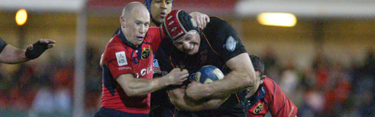 Ian Gough shrugs off the tackle of Peter Stringer in last season's encounter at Rodney Parade