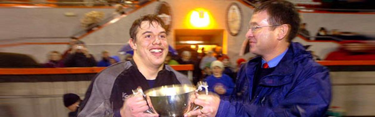 Roger Lewis, pictured here on Friday presenting Ospreys U18 Captain Jack Shaw with the Reebok Regional Championship Trophy, is looking forward to a special 2007 for rugby union in Wales