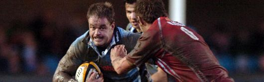 Xavier Rush skins past the Scarlets defence