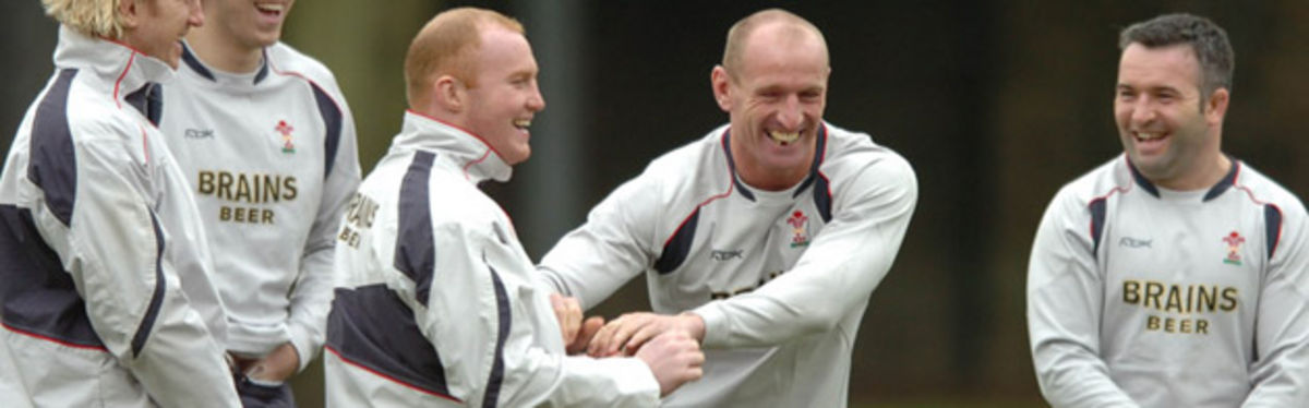 Martyn Williams enjoys some in-training hi-jinks with Gareth Thomas yesterday